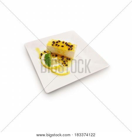 passion fruits crepe cake isolate on white backgrounnd
