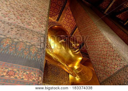 Ancient Reclining Buddha image inside Wat Pho. Wat Pho is famous temple and historical landmark of Thailand.