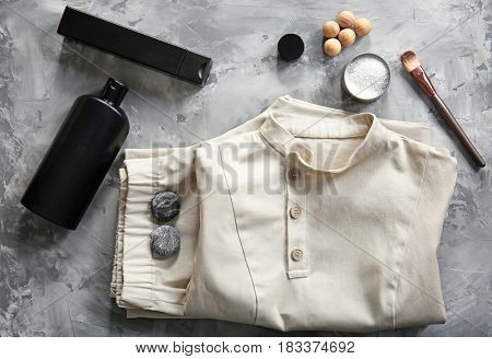 Composition with spa uniform on stone background