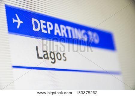 Computer screen close-up of status of flight departing to Lagos, Nigeria