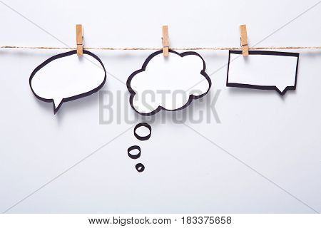 Creative ideas concept. Blank speech bubbles hadcrafted on white background, top view, copy space for text