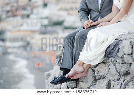 Bride and groom relaxing in wedding day in Positano Amalfi coast Italy