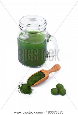 detox healthy lifestyle seaweed organic spirulina and chlorella pills and powder drink isolated on white background
