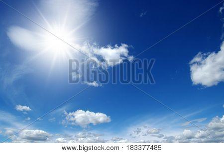 sun on blue sky backgrounds