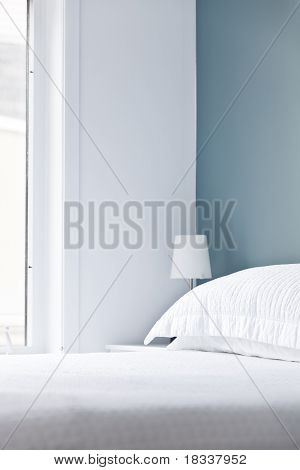 Bed, Pillow And Bedside Lamp