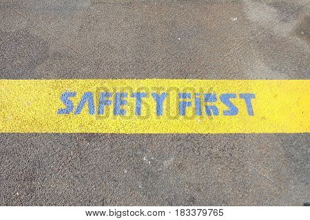 Safety First on Yellow Line on Pier Ground.