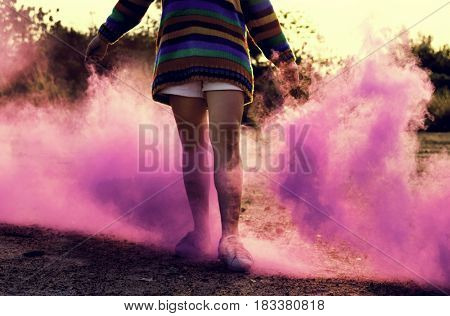 Woman Hands Holding Pink Smoke Bomb Outdoors