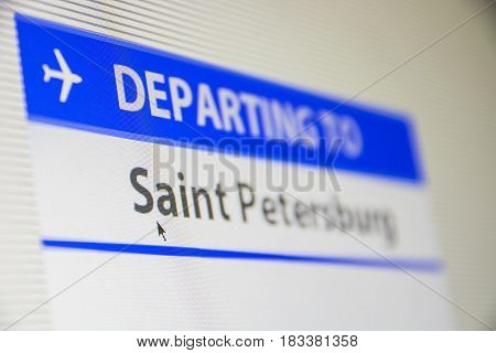Computer screen close-up of status of flight departing to Saint Petersburg, Russia