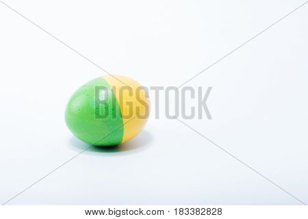 Easter Egg Hand Painted In Home - Yellow And Green, Isolated In White Background