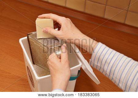 Woman shredding soap to make her own laundry detergent