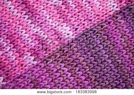 the texture of the knitted fabric with striped pattern in purple tones