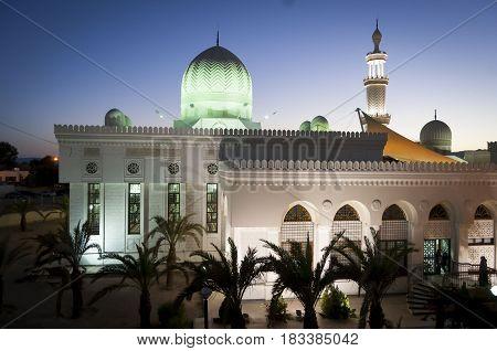 The beautiful mosque Sharif Hussein Bin Ali in Aqaba, lit up. Aqaba, Jordan. April 30, 2014