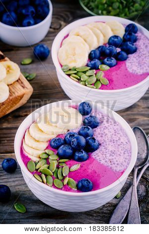 Healthy Breakfast: Purple Smoothie Bowl With Chia Pudding, Banana, Fresh Blueberries And Pumpkin See