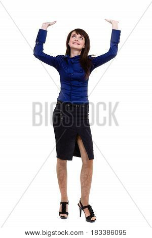 Business woman touching something imaginary. studio portrait standing full length isolated on white background