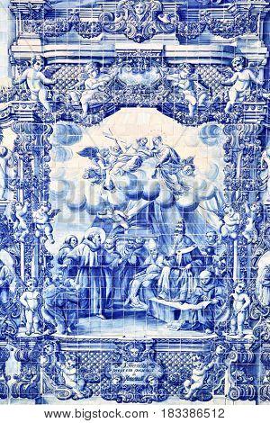 Porto, Portugal - May 13, 2012: Traditional portuguese tilework azulejo on outer wall of the Capela Das Almas De Santa Catarina church in Porto