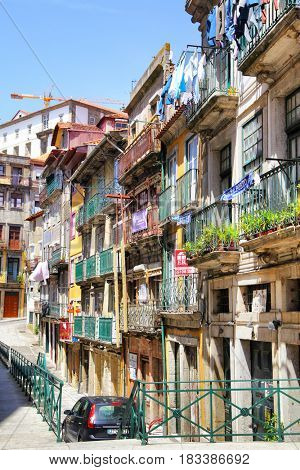 Porto, Portugal - May 13, 2012: Old street with colorful houses in downtown of Porto