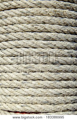 Old Rope Tied on Wooden Pole Background.