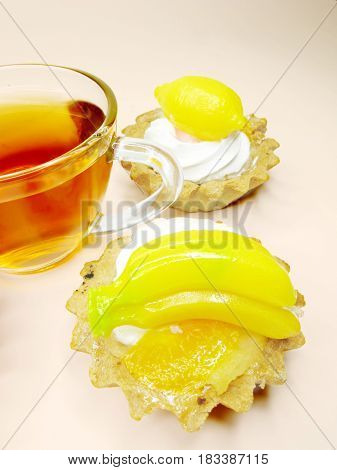 group of fancy cakes with marmalade fruits and tea