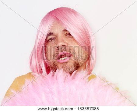 A Man With Pink Wig and Pink Lipstick Staring