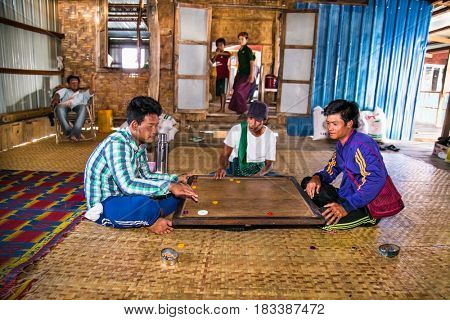 INLE, MYANMAR-MARCH 4, 2017: Unidentified burmes playing traditional game at floating village on March 4,2017, Inle Lake, Myanmar.(Burma)