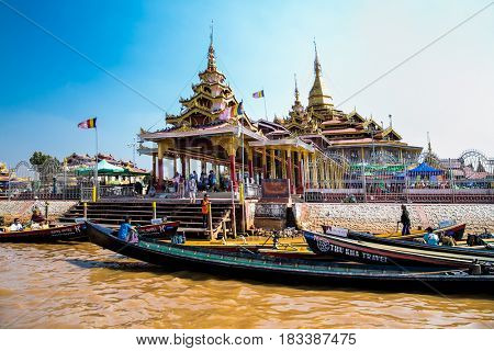INLE, MYANMAR-MARCH 4, 2017:  Transportation by boat in front of Phaung Daw Oo Pagoda on March 4, 2017, Inle lake, Shan state, Myanmar. (Burma)