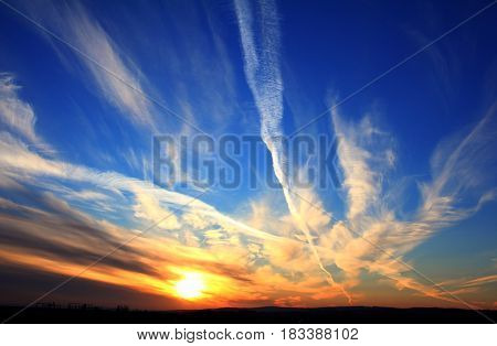 sky landscape with beautiful sunset over land