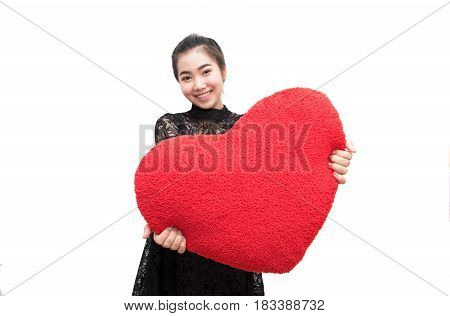 Beautiful Woman Is Showing Heart Pillow And Smiling Look Like Happy, In Love Concept.