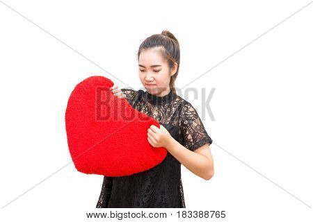Broken Heart Woman Is Angry And Try To Tear Heart Pillow On Isolated White Background