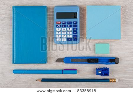 Blue Stationery Tools On Light Wooden Table