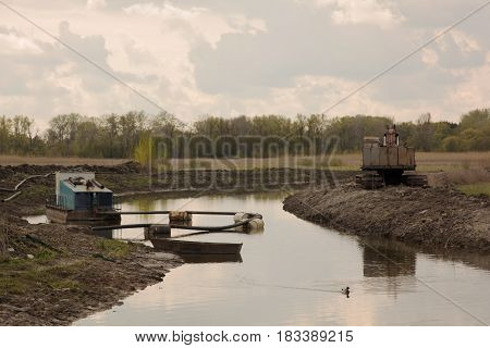Suction Dredge On Small River