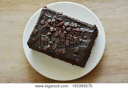 chocolate butter cake topping chips on white dish