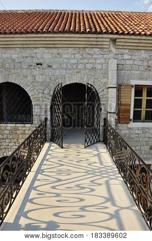 Bridge with iron forging and entrance to the old fortress