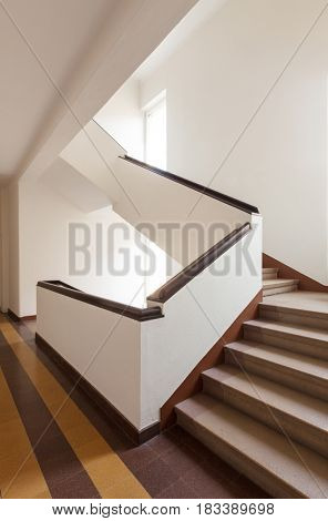 Brown stairway in a modern apartment