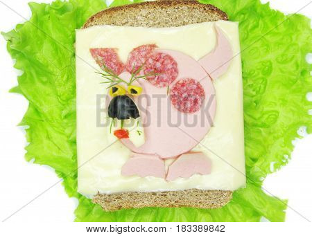 creative sandwich with cheese and ldog made of sausage
