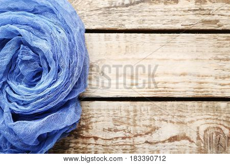 Blue Gauze Fabric On Brown Wooden Table