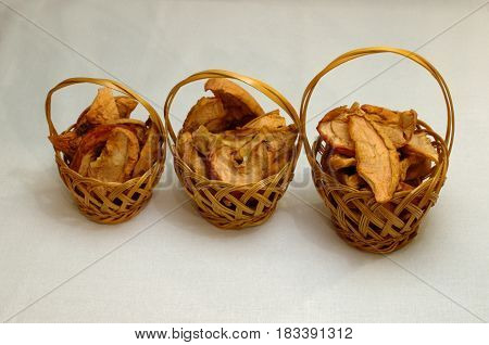 Three wicker baskets with dried apple chips
