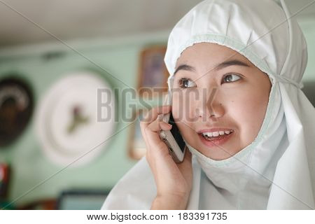 Muslim girl calling cellphone look like happy