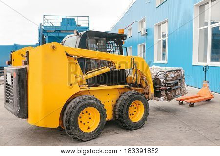 Forklift truck. Waste processing plant. Technological process. Recycling and storage of waste for further disposal. Business for sorting and processing of waste.