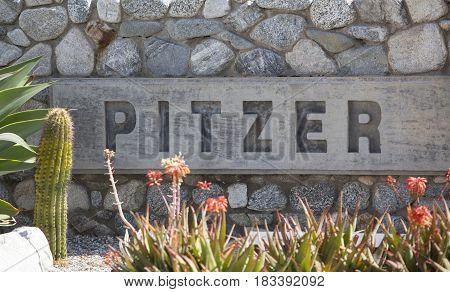 Claremont CA USA - April 14 2017: The sign for Pitzer College a liberal arts college in southern California just outside of Los Angeles.