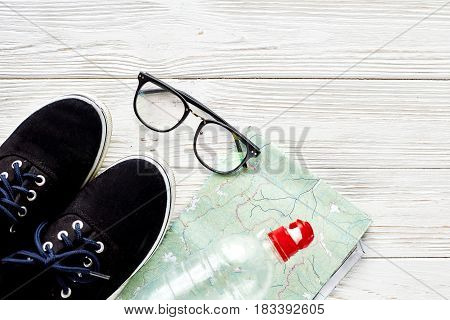 Fitness Concept With Sneakers And Water Bottle And Map Glasses On White Wooden Background, Hipster F