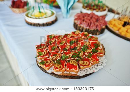 Table Catering With Bread Caviar And Snacks At Wedding Reception.