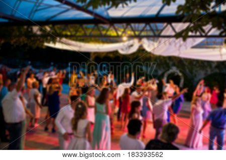 Blur Photo Of Crowd People Party Dance At Wedding Outdoor At Night.