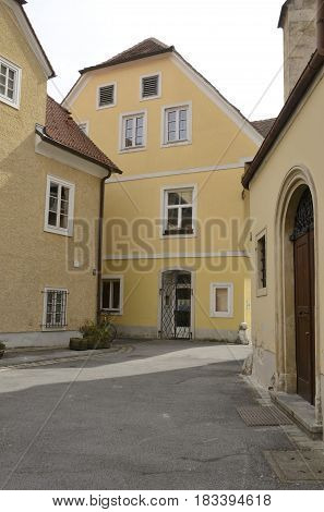 GRAZ, AUSTRIA - MARCH 20, 2017: Yellow houses in alley of the old town Graz the capital of federal state of Styria Austria.