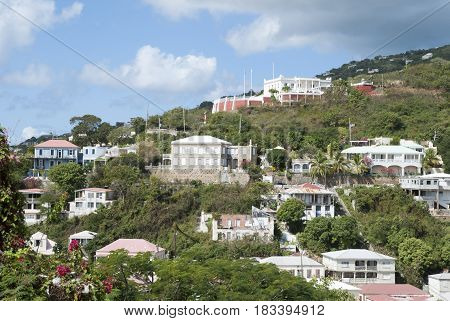 The view of Charlotte Amalie town buildings with government building on a top on St. Thomas island (U.S. Virgin Islands).