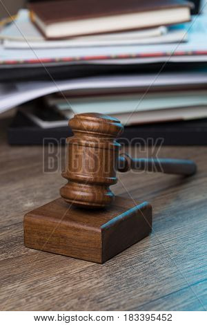 Hammer of judge against folder
