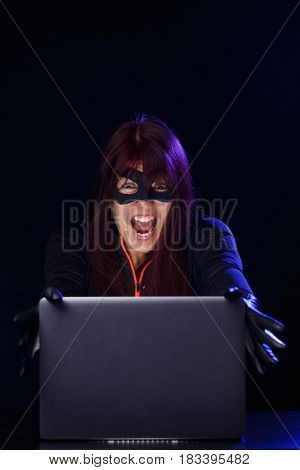 Screaming brunette hacker at night