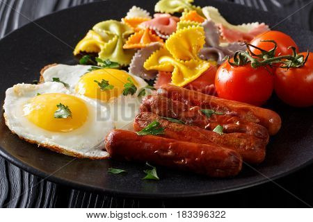 Homemade Breakfast: Fried Eggs, Sausages, Colored Farfalle Pasta And Tomato Close-up. Horizontal