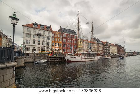 Copenhagen - August of  2014, Denmark: Old white ship in Nyhavn at cloudy day