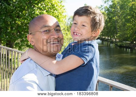 Father Of Indian Origin And His Son At The Edge Of A Bridge