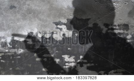 Angry Man Shadow and Comic Cloud on Concrete Wall.